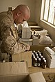 US Navy 080915-M-1269A-007 Hospital Corpsman 3rd. class Kyle Keeler, assigned to 1st Battalion, 3rd Marine Regiment, Regimental Combat Team 1, organizes medicine.jpg