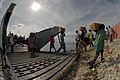 US Navy 080924-N-3595W-158 Haitians help Sailors offload disaster relief supplies from a landing craft, utility.jpg
