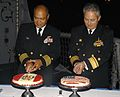 US Navy 090611-N-4879G-197 Commander of Destroyer Squadron (DESRON) 40 Capt. Rodelio Laco and Vicealmirante Carlos Chanduvi Salazar cut cakes during a reception aboard the guided missile frigate USS Doyle (FFG 39).jpg