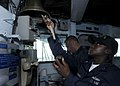 US Navy 090911-N-7478G-061 Boatswain's Mate 2nd Class Dale Marshall rings eight bells.jpg