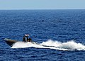 US Navy 100222-N-7058E-161 Sailors and Coast Guardsmen from the littoral combat ship USS Freedom (LCS 1), front, and Colombian navy sailors in a patrol boat search for illicit drugs dumped overboard by a high-speed.jpg