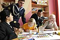 US Navy 100507-N-9094S-374 Mass Communication Specialist 3rd Class Alexandra Arroyo draws pictures at the Vladivostok children's cancer ward.jpg