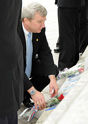 US Navy 100511-N-7128A-105 Mark Clookie, director of Naval Criminal Investigative Service (NCIS), pays his respects to a fallen NCIS agent at the National Law Enforcement Officers Memorial