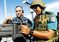 US Navy 100528-N-0995C-083 Gunner's Mate 1st Class Chad Schrine instructs an Indonesian National Armed Forces sailor.jpg