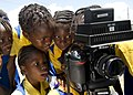 US Navy 110419-N-RM525-454 School children watch a video recording of themselves singing during a Continuing Promise 2011 community service project.jpg