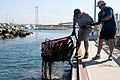 US Navy 110827-N-PB383-130 Navy divers assigned to Mobile Diving and Salvage Unit (MDSU) 1 pull a shopping cart out of San Diego Bay during Operati.jpg