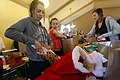 US Navy 111126-N-RC734-043 Volunteers stuff stockings and fill care packages for Sailors and marines deployed overseas as part of an outreach suppo.jpg