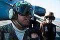 US Navy 111214-N-BT887-251 A Sailor talks to the pilot before a launch.jpg