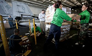US Navy 111221-N-OY799-173 Sailors move cargo during a replenishment at sea aboard the Nimitz-class aircraft carrier USS John C. Stennis (CVN 74).jpg
