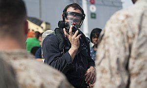 US Navy 120105-N-PB383-842 A Sailor demonstrates how to properly wear fire fighting equipment.jpg