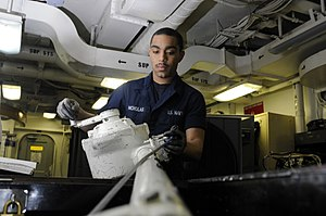 US Navy 120130-N-RG587-537 A Sailor reels in the load cable of a bomb hoist.jpg