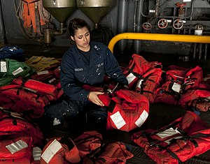 US Navy 120208-N-NL541-175 Seaman Jacqueline Brown, from New York, inspects float coats and life jackets in the hangar bay of the amphibious assaul.jpg