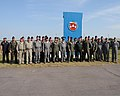Ukrainian air force pilots at Mirgorod Air Base, Ukraine, gather with U.S. Air Force pilots after sharing bread, a traditional Ukrainian custom, July 17, 2011, as part of Safe Skies 11 110717-F-VM486-682.jpg