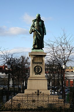 The sculpture of the poet Valentin Vodnik (1758-1819) was created by Alojz Gangl in 1889 as part of Vodnik Monument, the first Slovene national monument. V. Vodnik monument Ljubljana front side 2008-03.jpg