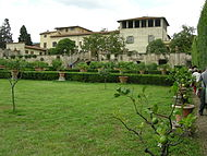 A decaying Tuscan villa stands against a clear-sky.