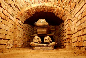 Coffin in a brick-lined crypt under the church...