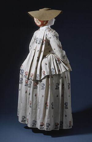Sack-back gown - Woven linen pet-en-l'air with sack back, worn with a matching petticoat. France or England, c.1770s. (LACMA) M.67.8.74