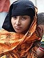 Woman outside Shrine of Hazrat Shah Jalal - Sylhet - Bangladesh (12988233694).jpg