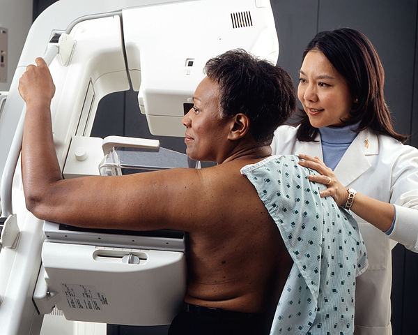 Woman receives mammogram