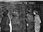Women Airforce Service Pilots check the tow schedule.JPG