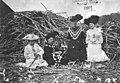 Women sitting in front of a sugarcane heap 1909.jpeg