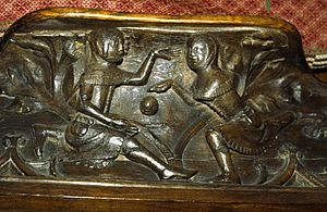 Medieval football - Youths playing ball depicted on a misericord at Gloucester Cathedral.