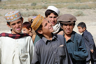 Paktika Province - Local Afghan children observe U.S. Army Special Forces and Afghan National Police as they patrol the area to improve security and increase stability in the village of Rabat.