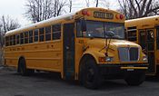 A 2003 IC CE conventional-style school bus owned by North Syracuse Central Schools.