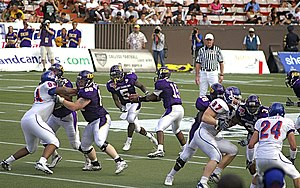 Rush (gridiron football) - Running back Chris Johnson of the East Carolina Pirates (No. 5) receiving the handoff and rushing the ball during the 2007 Hawaii Bowl.
