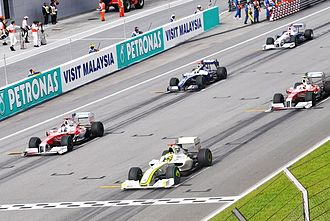 2009 Malaysian Grand Prix - Jenson Button took pole position on the starting grid, but Nico Rosberg (in fourth place) made the best start and led for the first time in his career, into the first corner.