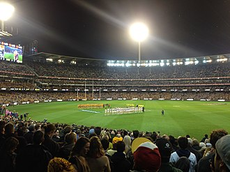 2016 AFL finals series - Geelong v Hawthorn. Both teams are lined up listening to the national anthem before the match commences.