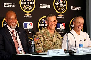 Tony Clark - Clark (left), Lt. Gen. Stephen J. Townsend (center), and Rob Manfred (right) before the Fort Bragg Game in 2016