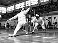 2nd Leonidas Pirgos Fencing Tournament. The fencer on the right had just performed a lunge and has scored a touch.jpg