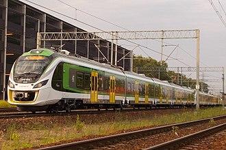 Rail transport in Poland - A Koleje Mazowieckie train approaching a station