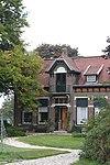 foto van Boerderij met dubbel woonhuis en bedrijfsdeel met staart