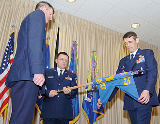 Guidon (United States) - Air Force personnel case a squadron guidon as part of an inactivation ceremony.