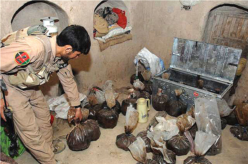 File:ANA soldier shows opium captured in an alleged Taliban safe house in Helmand.jpg