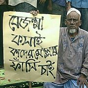 A Bangladeshi 60 plus old man carrying the playcard in Shahbag Mass Movement of 2013 in Bangladesh demanding capital punishment for the accused world criminal Abdul kader Molla.jpg