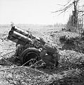 A British soldier examines an abandoned German 'Nebelwerfer' near Troarn, Normandy, 20 July 1944. B7785.jpg