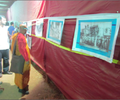 A Buddhist monk watching photo exhibition at Chaitya Bhoomi.png