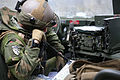 A Norwegian soldier requests a medical evacuation for a simulated casualty during a military adviser team (MAT) and police adviser team (PAT) training exercise at the Hohenfels Training Area, a part of the Joint 131210-A-RJ750-114.jpg