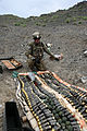 A U.S. Soldier assigned to the 706th Explosive Ordnance Disposal Company, Task Force 4-25 organizes ordnance for destruction at the demolition range at Forward Operating Base Salerno in Khost province 120902-A-PO167-090.jpg