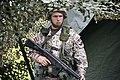 A Zemessardze (Latvian National Guardsman) guards the battalion tactical operations center during the Strong Guard 2016 (Zobens 2016).jpg