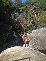 A tourist exploring small waterfall at Shivpuri National Park.jpg