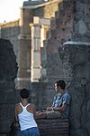 A young couple relaxing and chatting at the Roman Forum - 3107.jpg