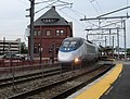 Acela passing New London station.JPG