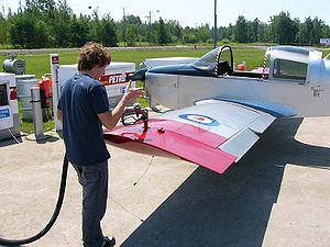 Avgas - An American Aviation AA-1 Yankee being refueled with 100LL avgas