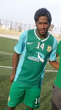 Amjad Kalaf in Al-Shorta kit after match with Al-Samawa, 26 April 2014.jpg