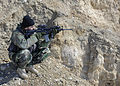 An Afghan National Army commando provides security during an operation to disrupt a Taliban weapons storage and improvised explosive device manufacturing network in Jaghatu district, Wardak province 120224-N-MF277-226.jpg