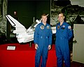 Astronauts John Fabian and Dave Walker pose in front of a model of the Shuttle-Centaur.jpg